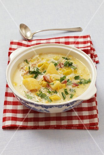 Leek and potato soup with sour cream and bacon