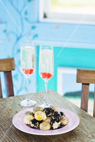 Small poppy seed & sesame pastries with two glasses of champagne