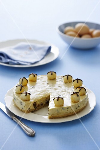 Cheesecake with dried fruit and marzipan balls