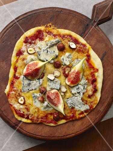 Pizza topped with Gorgonzola, figs and hazelnuts