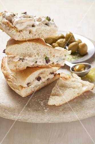 Flatbread filled with Greek sandwich spread