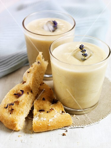 Cold vichyssoise in glass with ice cubes and flatbread