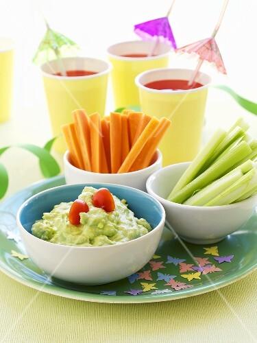 Vegetable sticks and avocado dip for children