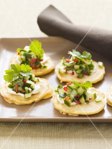Potato pikelets with cucumber salsa