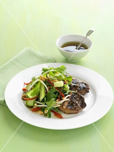 Steak with cucumber and coriander salad