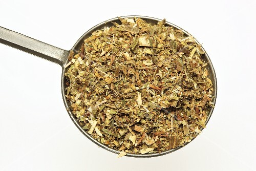 Dried golden rod leaves on measuring spoon
