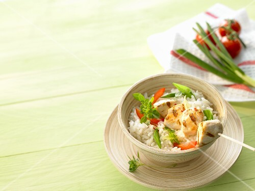 Rice with grilled chicken skewer and vegetables