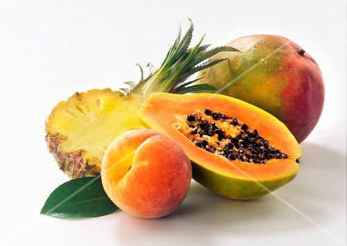 Summer fruits: pineapple, papaya, peach and mango