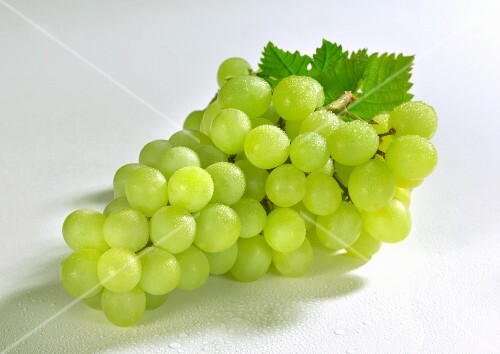Freshly washed green grapes with leaves