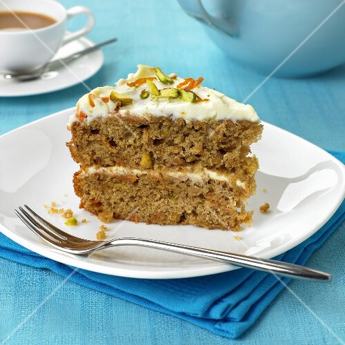 A piece of carrot cake with mascarpone filling