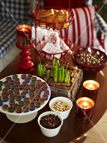 Chocolates, almonds, candles in glasses & container of bulbs