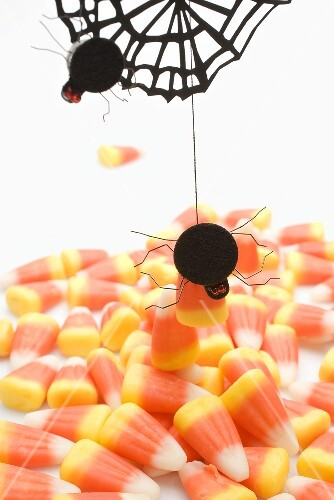 Candy corn with spiders and cobweb for Halloween