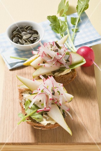 Radishes and pear on wholemeal rolls