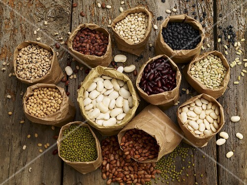 Various types of dried beans in paper bags