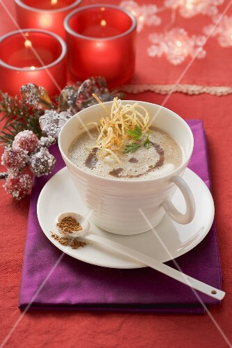 Potato and plum foam soup with cinnamon