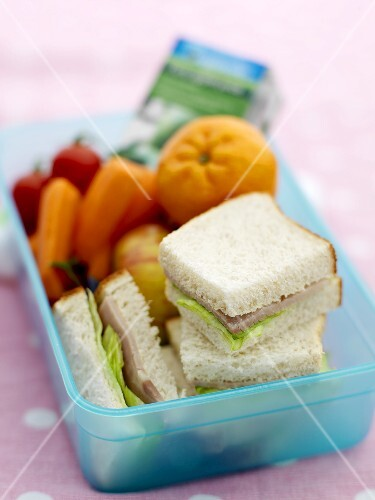 Sandwiches, fruit and vegetables in a lunch box