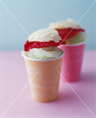 Lemon and berry sorbets in two paper cups