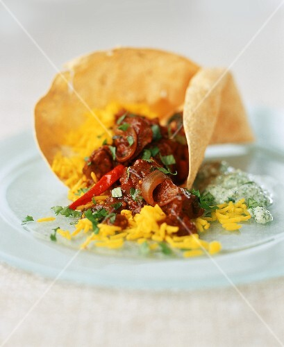 Spicy lamb curry with saffron rice and poppadom