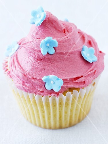 Cupcake with pink icing and sugar flowers