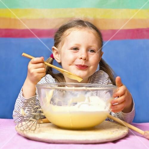 Little girl tasting home-made ice cream