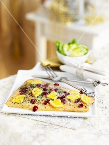 A fillet of salmon with oranges and cranberries for Christmas dinner