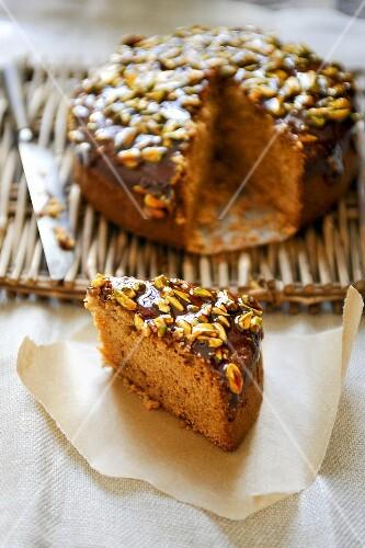 A sliced honey and pistachio cake