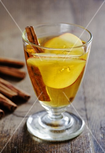 Two Glasses of Apple Cider; Bundle of Cinnamon Sticks
