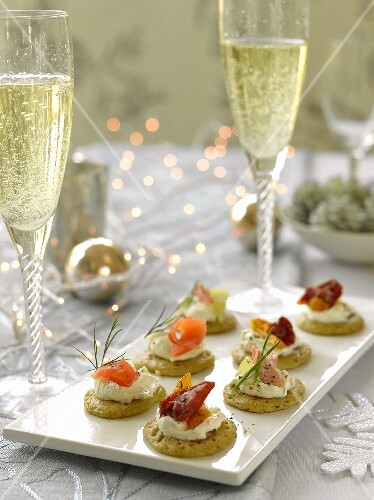 Blinis with various toppings and champagne
