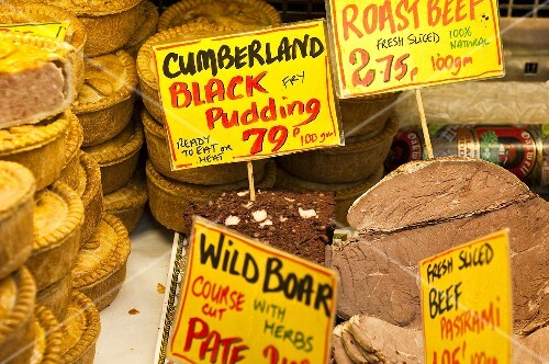 English pies and meat with price labels at a market