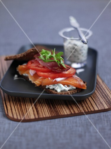 Smoked salmon with cream cheese and tomatoes on rye bread