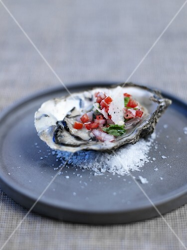 Oyster bruschetta with diced tomatoes and parmesan