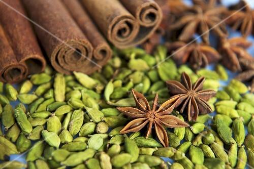 Assorted spices (cardamom, star anise and cinnamon sticks)
