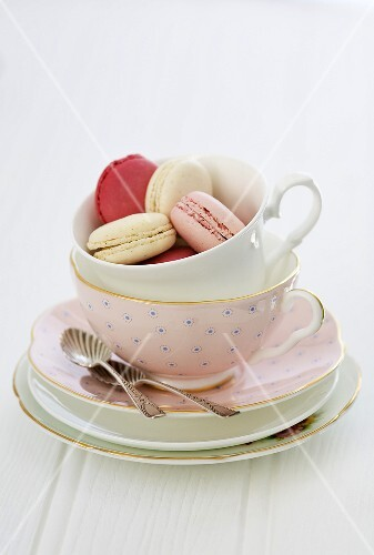 Macaroons in a pink tea cup