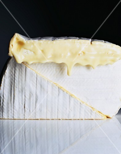 Three pieces of brie, one overripe and dripping