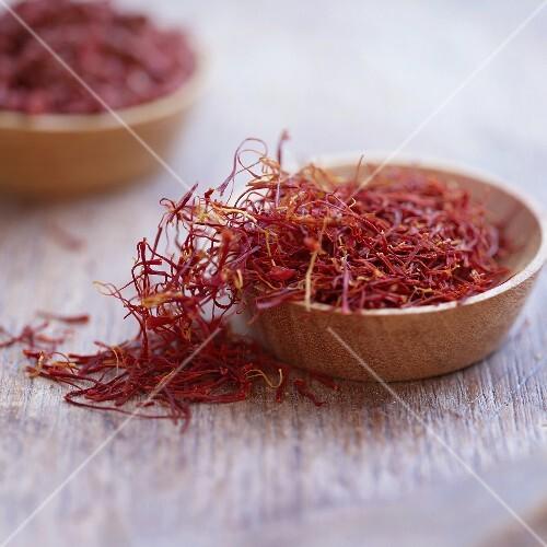 Saffron threads in wooden bowls