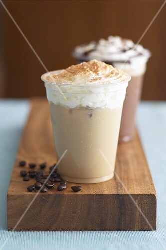 Eiskaffee (iced coffee drink) with cream in two beakers