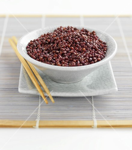 Azuki beans in bowl with chopsticks