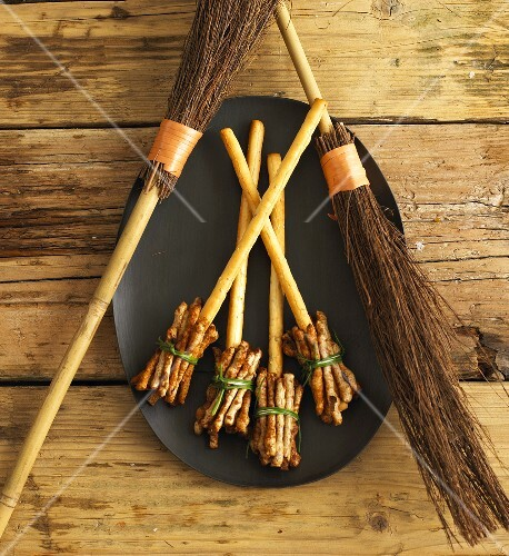 Witches' broomsticks made from savoury sticks (Halloween)