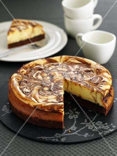 Mocha cheesecake, a piece removed