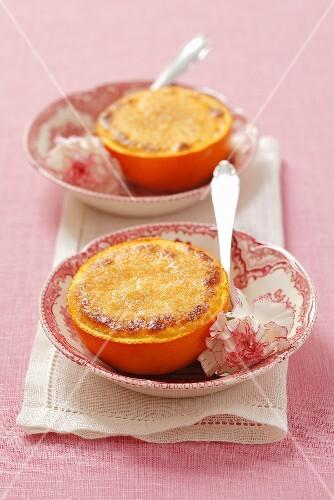 Creme brulee with orange halves