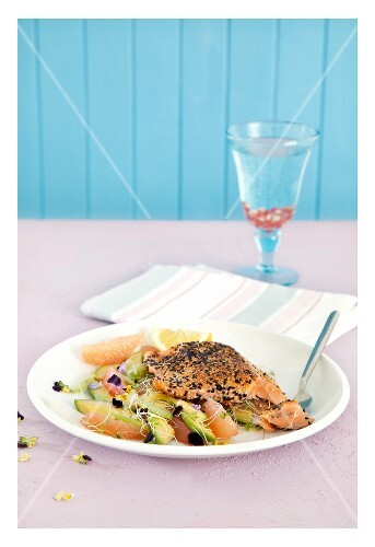 Salmon with a sesame coating with grapefruit, avocado and celery