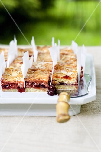 Sour cherry cake with slivered almonds, sliced