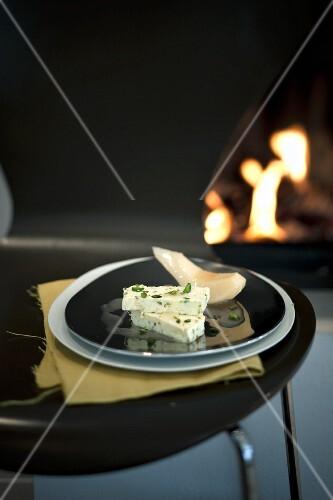 Pistachio parfait with slices of quince