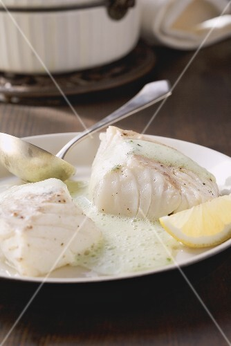 Poached cod with herb sauce