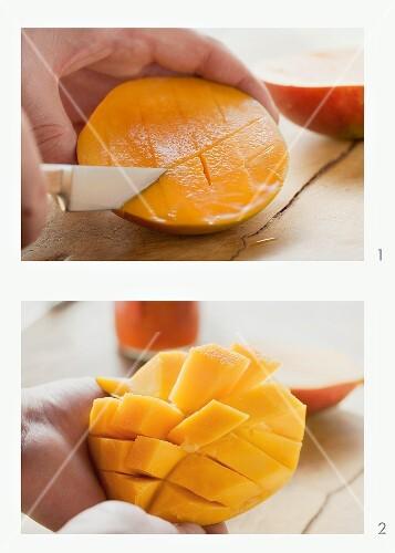 Mango flesh being cut in a grid pattern