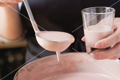 Zabaione being poured into a glass