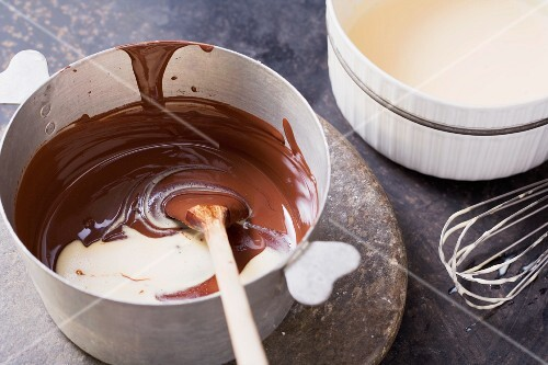 Melted chocolate being stirred into a milk-cream-egg yolk mixture