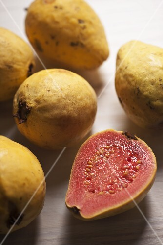 Guavas, whole and halved