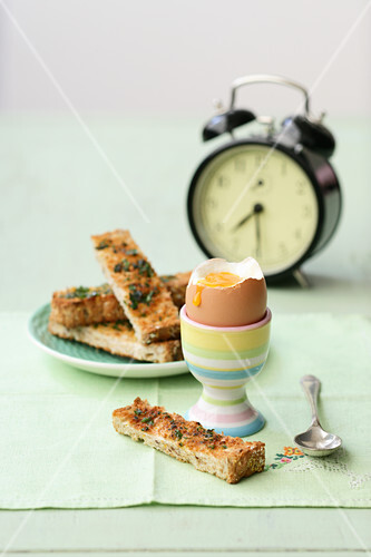 A soft boiled egg with soldiers