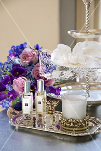 Wedding accessories: perfume, scented candles and the bridal bouquet
